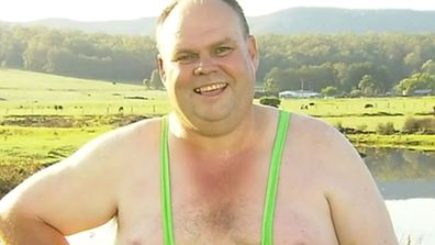 Farmer celebrates rain by running into creek in yellow 'mankini'