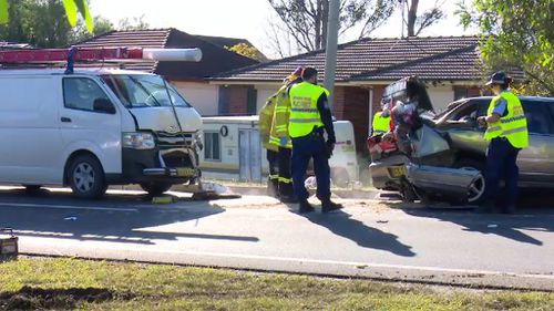 The two men in the van escaped injury. (9NEWS)