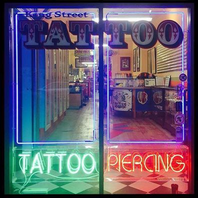 Sydney tattoo parlour condemned after employee's 'up-skirting' incident resurfaces