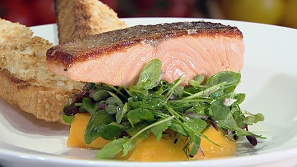 Crispy skinned salmon fillet with baby herbs