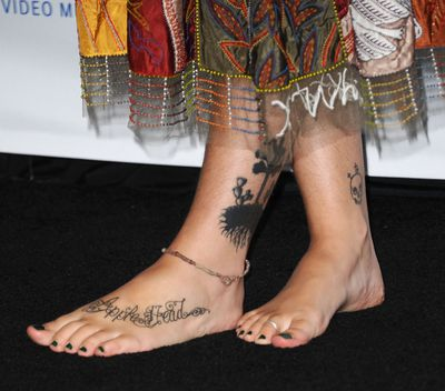 Tattoos haven't prevented rising model Paris Jackson from signing a seven-figure deal to work with Calvin Klein.