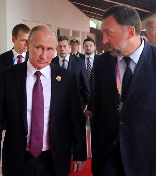 Oleg Deripaska (right) is a close friend and associate of Vladimir Putin.