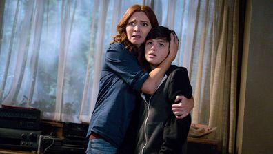 Logan Williams stars with Brigid Brannagh on The Flash.