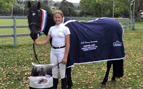 Lauren Grocott, pictured with her horse Liquorice, who appeared to be trying to protect her as it fell.