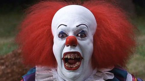 Pennywise in the 1990 original film, played by Tim Curry. (IMDB)
