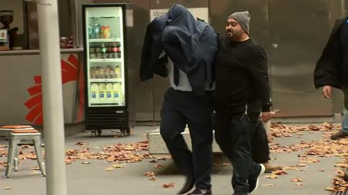 Hassan Abdallah walked into court with the assistance of another man. (9NEWS)