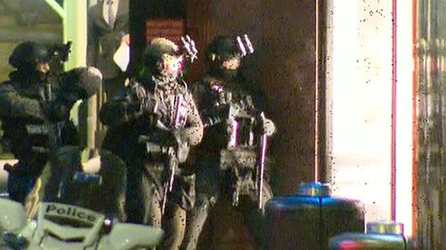 Police surround the Lindt cafe during the tense siege.