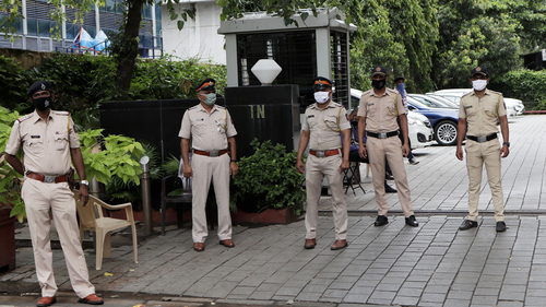 Indian policemen guard outside Chinese consulate anticipating protests in Mumbai, India, Wednesday, June 17, 2020.