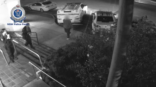 The man approaches the officers on the steps of Eastwood police station. Picture: NSW Police