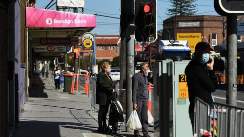 People walk past shops on Forrest Road in Bexley, Sydney. during the COVID-19 lockdown.