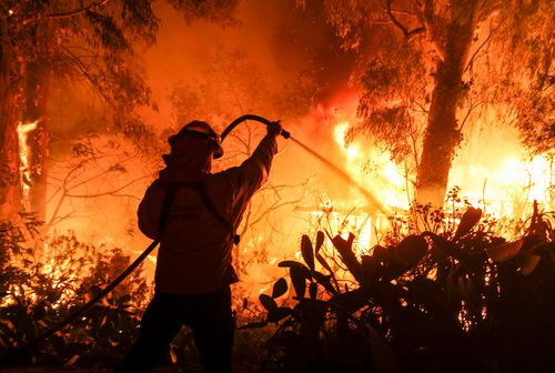 Authorities announced that more than a quarter of a million people are under evacuation orders as wind-whipped flames rage through scenic areas west of Los Angeles.