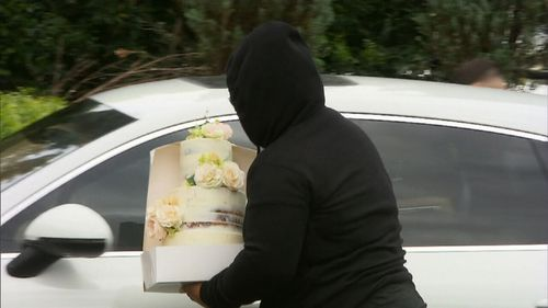 A guest was seen toting what appeared to be a wedding cake. (9NEWS)