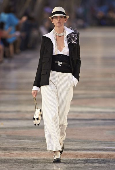 Karl Lagerfeld docked in Havana, Cuba, for Chanel's 2016/17 Cruise Collection. An explosion of colour and fun, the collection, which was held in the historicPaseo del Prado, riffed on classic Cuban silhouettes and motifs from mambo music and cigars to the guayabera and Panama hat.