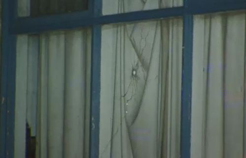 A bullet pierced through the front window of the property. Picture: 9NEWS