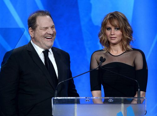 Producer Harvey Weinstein and Jennifer Lawrence speak onstage during the 24th Annual GLAAD Media Awards, in 2013.