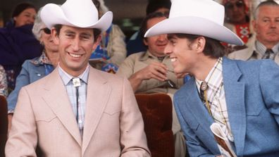 Prince Charles, Prince of Wales (left) and Prince Andrew, Duke of York (right) dress as cowboys on March 1, 1977 at Calgary in Canada