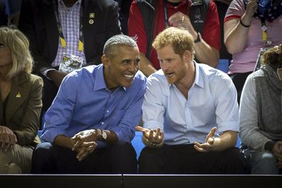 Former U.S. President Barack Obama and Prince Harry watch wheelchair basketball at the Invictus Games in Toronto.