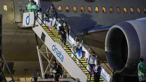 Tennis players and their support teams are seen disembarking Flight EY460 carrying tennis players and their support teams participating at the Australian Open at Melbourne Jet Base adjoining the Melbourne International airport on January 14, 2021 in Melbourne, Australia