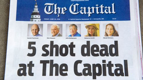 The front page of The Capital Gazette in Annapolis, Maryland, shows the five people killed in a newsroom shooting: John McNamara, Wendi Winters, Rob Hiaasen, Gerald Fischman and Rebecca Smith.