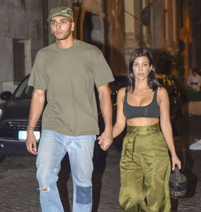 """<p>If you're not wearing your underwear as outerwear, are you even living?&nbsp;</p> <p>Not according to the Kardashian Jenner clan. Case in point, <a href=""""Kourtney leaves little to the imagination on night out"""" target=""""_blank"""" draggable=""""false"""">Kourntey Kardahsian</a>'s latest dinner attire. </p> <p>The reality TV star went to dinner overnight in Rome, Italy, with boyfriend Younes Bendijama wearing an itsy bitsy black Yeezy bra. Because sometimes it's too hot to wear a top too, right?</p> <p>The <em>Keeping up with the Kardashians</em> star paired the crop top with high waisted wide leg pants, a Fendi bag and white sneakers.</p> <p>The 39 year-old is in Rome on vacation with her much younger beau, 25, taking in all the tourist attractions.</p> <p>The mother of three isn't the only one in the family who believes less is more. Her younger sister <a href=""""https://style.nine.com.au/2018/06/19/10/07/kylie-jenner-clothes-pants-alexander-wang-fashionhttps://style.nine.com.au/2018/06/19/10/07/kylie-jenner-clothes-pants-alexander-wang-fashion"""" target=""""_blank"""" draggable=""""false"""">Kylie Jenner</a> stepped out for dinner in Hollywood earlier this week wearing a tiny white bralette, paired with a pair of tight, form-fitting Alexander Wang leggings and nude Yeezy PVC mules.</p> <p>Click through to take a look at some of the standout moments the Kardashian Jenner ladies have ditched clothes in favour of underwear for a night out on the town.</p>"""