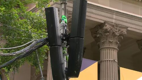 Speakers outside the State Library on Swanston Street. (9NEWS)
