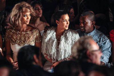 Seasoned model Tyra Banks accompanies lovebirds Kim Kardashian and Kanye West to a runway show.