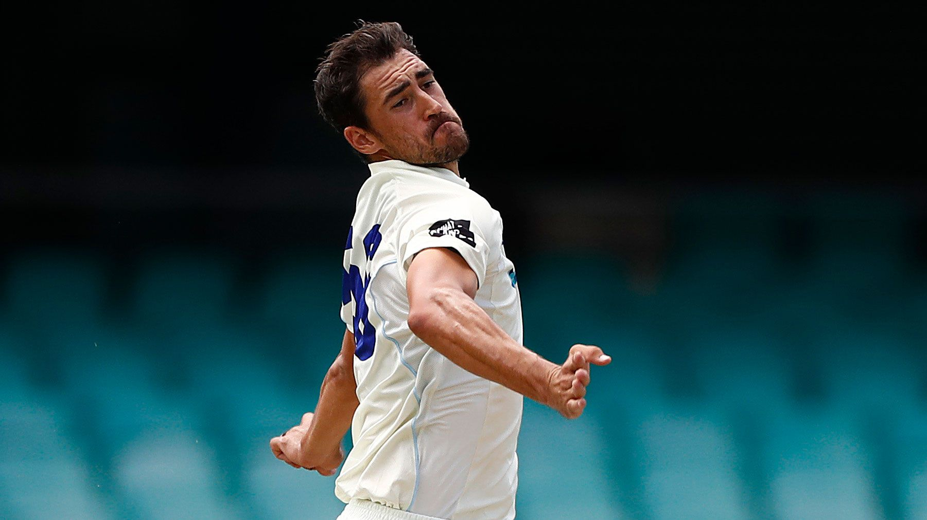 Mitchell Starc bowls for NSW in a Sheffield Shield game.