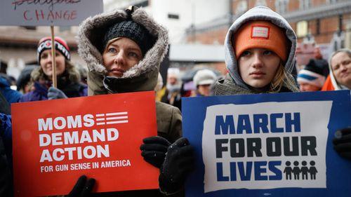 Demonstrators gather outside city hall in Cincinnati, Ohio. (EPA/AAP)