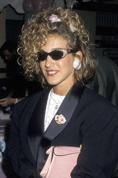Sarah Jessica Parker may have infamously scorned scrunchies as Carrie Bradshaw in Sex and the City but back in the '80s they were part of the actress's cool, thrown together aesthetic.