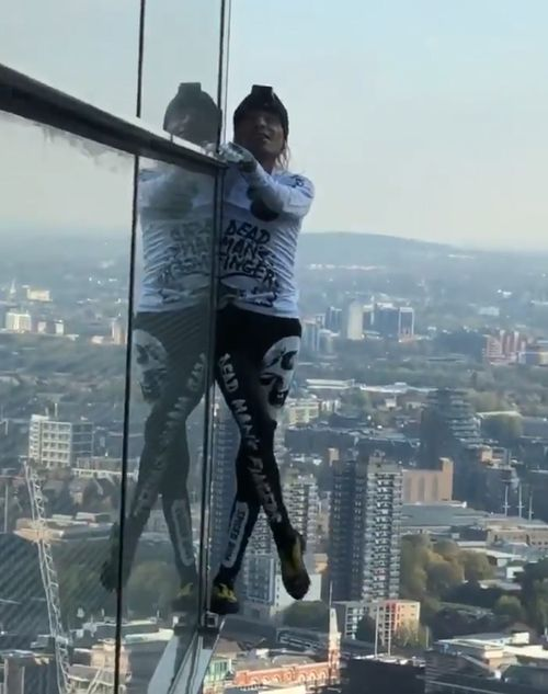 A 56-year-old man has scaled one of England's tallest buildings without the support of wires.