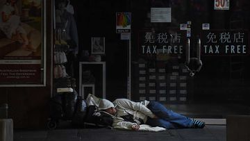 A man sleeps on George street in Sydney's CBD.