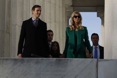 Jared wore a sky blue dress shirt and tie, teamed with a classic coat in navy. Ivanka added a touch of mystery with dark over-sized sunglasses leading some to compare her to the former First Lady the late Jackie Kennedy Onassis.