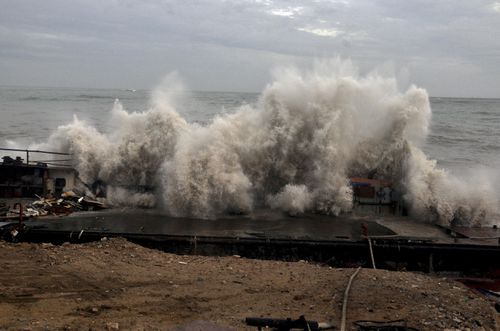 A waves crashes on the Arabian Sea coast in Porbandar, Gujarat, India. (AP Photo)