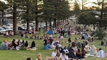 Crowds pack Burleigh Hill on the Gold Coast on Sunday, May 3, forcing police to move people on. Queensland.