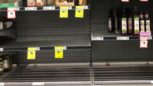 Townsville residents have experienced shortages in shops but retailers say extra supplies are heading to affected areas.