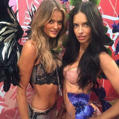 You can't accuse new girl Kate Grigorieva of not making friends: here she is with Adriana Lima.