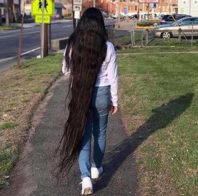 Real-life Rapunzel donates record-breaking hair