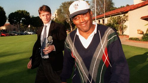 O.J. Simpson smiles as he walks away from reporters after playing a round of golf at Rancho Park Golf course in Los Angeles in 1997.
