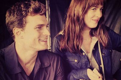"""<i>Fifty Shades of Grey</i> director <b>Sam Taylor-Johnson</b> just shared this adorable behind-the-scenes snap from the set of her upcoming racy flick.<br/><br/>And is it just us or do Jamie Dornan and Dakota Johnson look like they have great chemistry?! Hell, they'll need it for some of those raunchier scenes.<br/><br/>But if this isn't enough to curb your appetite for the raunchy romp-fest, then settle in and get comfy in your boudoir as we look under the covers of the <i>Fifty Shades</i> film set...<br/><br/><i>Author: <b><a target=""""_blank"""" href=""""https://twitter.com/yazberries"""">Yasmin Vought</a></b>. Approved by Adam Bub.</i>"""