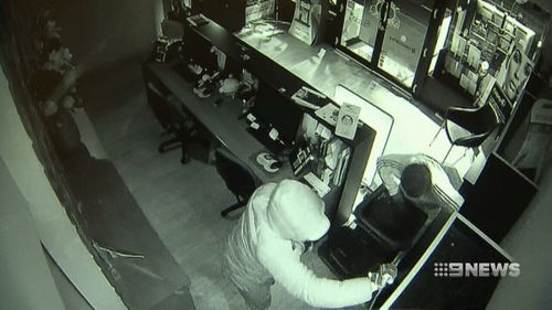 A group of thieves used a boulder to break into two businesses in Melbourne's Kew.