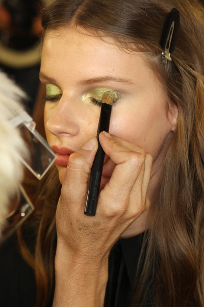 "<p>Backstage makeup artist Pat McGrath created a fresh take on the smokey eye. ""We're doing it with pale shimmery greens,"" she told WWD.&nbsp;</p>"