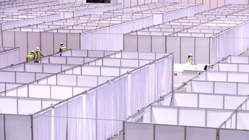 "Workers set up an ""alternate care facility"" at McCormick Place Hall A in Chicago."