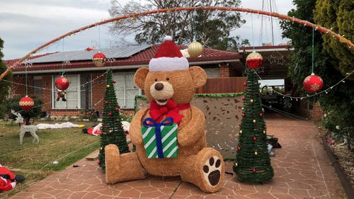A giant teddy stolen from outside a Sydney home is back on display, helping its owner raise funds for charity.