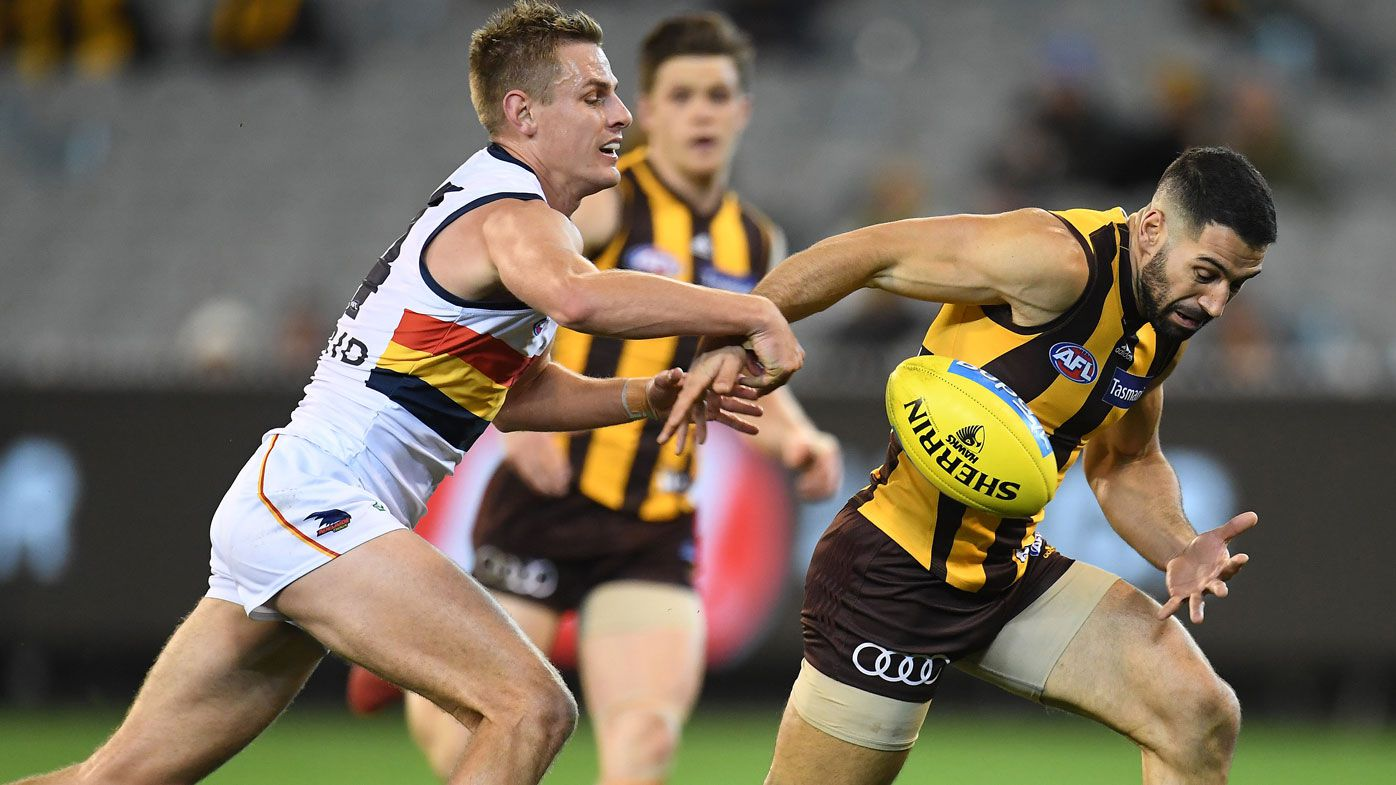 Crows in crisis as Hawks storm to AFL win