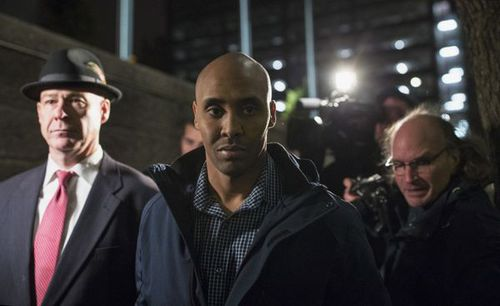 Mohamed Noor  shot across his partner and hit Ms Ruszczyk in the stomach.