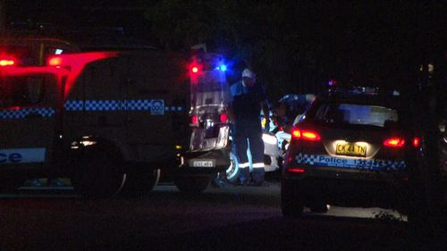 Forensic police spent the night examining the apartment block. (9NEWS)