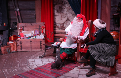 Santa Claus sits in his chamber at the Santa Claus Village, in Rovaniemi, Finland. Rovaniemi is the provincial capital of Finnish Lapland and is situated on the Arctic Circle, it is also the official hometown of Santa Claus