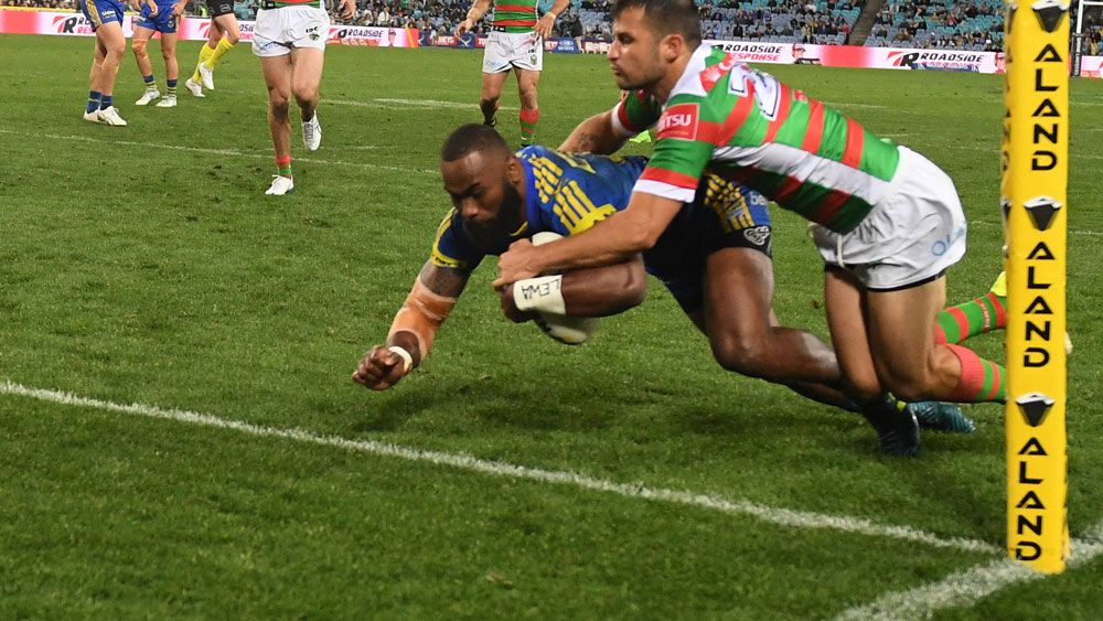 Semi Radradra crosses for his first try against South Sydney. (AAP)