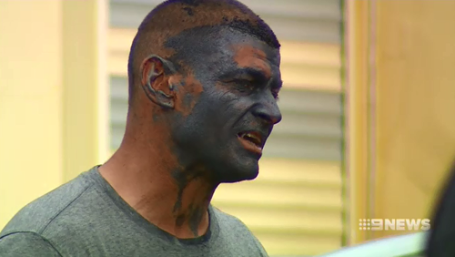 Police located the suspect who had dark paint stained across his face and shirt.