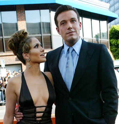 """Actors Ben Affleck and Jennifer Lopez attend the premiere of Revolution Studios' and Columbia Pictures' film """"Gigli"""" at the Mann National Theatre July 27, 2003 in Westwood, California."""